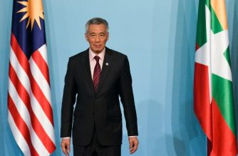 """(FILES) In this file photo taken on April 28, 2018 Singapore Prime Minister Lee Hsien Loong waits for leaders to gather for a group photograph after delivering his opening address at the 32nd ASEAN (Association of Southeast Asian Nations) Summit in Singapore on April 28, 2018. Hackers have stolen health records belonging to 1.5 million Singaporeans, including Prime Minister Lee Hsien Loong who was specifically targeted in the """"unprecedented"""" attack, authorities said on July 20. / AFP PHOTO / ROSLAN RAHMAN"""