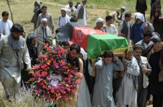 """Relatives, colleagues and friends carry the coffin of AFP driver Mohammad Akhtar at a ceremony in Kabul on July 23, 2018, a day after he was killed in a suicide attack in the Afghan capital. AFP driver Mohammad Akhtar, a 31-year-old father of four who was among 23 people killed in a suicide attack in Kabul, was a """"great friend"""" known for his kindness and honesty, colleagues said July 23.  / AFP PHOTO / NOORULLAH SHIRZADA"""