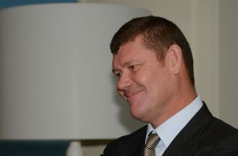 "High profile Australian identity James Packer speaks with a guest at the launch of the Harper Collins published book ""Killing Fairfax : Packer, Murdoch and the Ultimate Revenge"" by author Pamela Williams in Sydney on July 23, 2013. The book is described as covering a decade and a half of lost opportunity and mismanagement, with the story tracing the catastrophic loss of media company Fairfax's classified advertising market to the internet.  AFP PHOTO / Greg WOOD / AFP PHOTO / GREG WOOD"