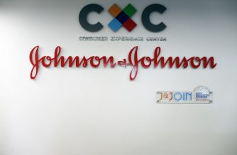 FILES: A picture taken on November 30, 2017 shows the logo of US multinational medical devices and pharmaceutical company Johnson & Johnson at the entrance of the research and development plant, in Val-de-Reuil, northwestern France. / AFP PHOTO / CHARLY TRIBALLEAU
