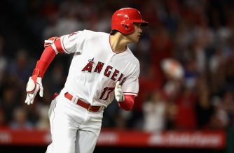 ANAHEIM, CA - JULY 10: Shohei Ohtani #17 of the Los Angeles Angels of Anaheim runs to first base after hitting a single during the eighth inning of a game against the Seattle Mariners at Angel Stadium on July 10, 2018 in Anaheim, California.   Sean M. Haffey/Getty Images/AFP