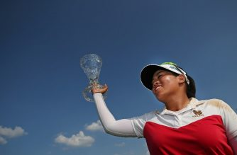 SYLVANIA, OH - JULY 15: Thidapa Suwannapura of Thailand poses with the trophy after winning the Marathon Classic Presented By Owens Corning And O-I at Highland Meadows Golf Club on July 15, 2018 in Sylvania, Ohio.   Matt Sullivan/Getty Images/AFP