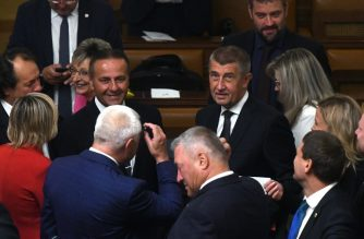 Czech Prime Minister Andrej Babis (c) is seen with deputies of ANO Party prior to the speech of Czech President Milos Zeman (unseen) in the Czech Parliament in Prague, Czech Republic on July 11, 2018.  / AFP Photo/ Michal Cizek