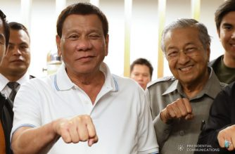 President Rodrigo Roa Duterte strikes his signature pose with Malaysia Prime Minister Mahathir Bin Mohamad after Senator Emmanuel Pacquiao earned a knockout victory to claim the World Boxing Association (WBA) Welterweight title at the Axiata Arena in Kuala Lumpur, Malaysia on July 15, 2018. Pacquiao stopped Lucas Matthysse in the seventh round of their bout. KING RODRIGUEZ/PRESIDENTIAL PHOTO