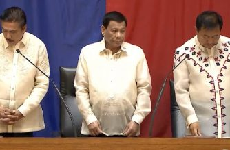 "President Rodrigo Duterte stands at the podium before he started his State of the Nation Address on Monday, July 23, 2018 together with Senate President Vicente ""Tito"" Sotto III and House Speaker Pantaleon Alvarez.  (Photo grabbed from RTVM video)"