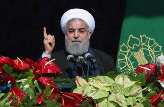 "(FILES) A handout picture provided by the office of Iranian President Hassan Rouhani on on February 11, 2018 shows him delivering a speech at Azadi Square in the capital Tehran during a ceremony to mark the 39th anniversary of the Islamic Revolution. President Hassan Rouhani called for a ""year of unity"" as Iran celebrated 39 years since the Islamic revolution Sunday in the wake of protests that rocked the country. / AFP Photo / Iranian   Presidency / Stringer"