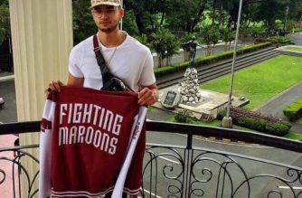 This picture shows Kobe Paras holding a UP Fighting Maroons jacket in the UP Diliman premises. /UP Fighting Maroons Twitter account/