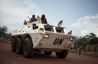 Tanzanian soldiers from the UN peacekeeping mission in the Central African Republic (MINUSCA), patrol the town of Gamboula, threatened by the Siriri group, on July 6, 2018.  / AFP Photo / Florent Vergnes