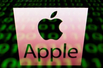 This illustration picture taken on April 29, 2018, shows the logo of Apple displayed on a screen and reflected on a tablet in Paris.  / AFP PHOTO / Lionel BONAVENTURE