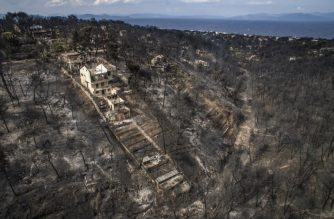 (FILES) In this file photo taken on July 24, 2018 an aerial view shows damage caused by a wildfire near the village of Mati, near Athens.   The Greek government is heavily criticised for its management of the deadly fires that destroyed, end of July, a seaside region on the east of Athens, and that killed 90 people, according to a new report. The government replaced on August 5, 2018 the chiefs of the police and the firefighters departments.  / AFP PHOTO / Savvas KARMANIOLAS