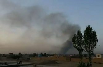 This screen grab taken from AFPTV video on August 10, 2018 shows smoke rising into the air after Taliban militants launched an attack on the Afghan provincial capital Ghazni, with terrified residents cowering in their homes amid explosions and gunfire. At least one Afghan soldier had been killed and seven others wounded in the fighting in the southeastern city of Ghazni, a provincial governor spokesman told AFP on August 10. / AFP PHOTO / AFPTV / AFPTV