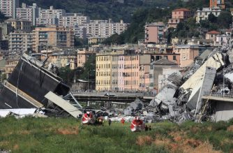 Rescuers work at the site where the Morandi motorway bridge collapsed in Genoa on August 14, 2018. At least 30 people were killed on August 14 when the giant motorway bridge collapsed in Genoa in northwestern Italy. The collapse of the viaduct, which saw a vast stretch of the A10 freeway tumble on to railway lines in the northern port city, was the deadliest bridge failure in Italy for years, and the country's deputy transport minister warned the death toll could climb further. / AFP PHOTO / Valery HACHE