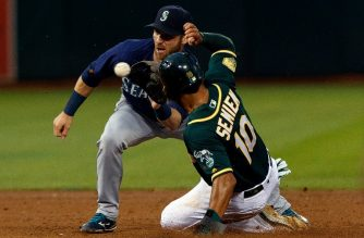 (FILES) In this file photo taken on August 13, 2018 Marcus Semien #10 of the Oakland Athletics steals second base ahead of a tag from Andrew Romine of the Seattle Mariners during the third inning at the Oakland Coliseum in Oakland, California. The Athletics and Mariners will launch the 2019 Major League Baseball season with a two-game series in Tokyo, league chiefs confirmed on August 22, 2018. The two-game series on March 20-21 at the Tokyo Dome starts a season which also includes international stops in London and Mexico as baseball aims to broaden its appeal. / AFP PHOTO / GETTY IMAGES NORTH AMERICA / Jason O. Watson