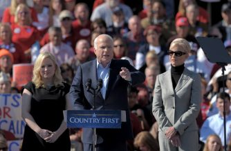 "(FILES) In this file photo taken on November 01, 2008 US Republican presidential candidate John McCain (C) speaks during a rally in Springfield, Virginia, with his wife Cindy (R) and daughter Meghan (L).  US senator John McCain, a celebrated war hero known for reaching across the aisle in an increasingly divided America, died Saturday after losing a battle to brain cancer, his office said. He was 81. ""Senator John Sidney McCain III died at 4:28pm on August 25, 2018. With the senator when he passed were his wife Cindy and their family,"" his office said in a statement. ""At his death, he had served the United States of America faithfully for 60 years."" / AFP PHOTO / Mandel NGAN"