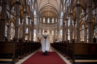 PITTSBURGH, PA - AUGUST 15: A Catholic priest walks to the sanctuary following a mass at the St. Paul Cathedral, the mother church of the Pittsburgh Diocese on August 15, 2018 in Pittsburgh, Pennsylvania. The Pittsburgh Diocese was rocked by revelations of abuse by priests the day before on August 14, 2018.  Jeff Swensen/Getty Images/AFP