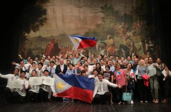 UPSA members and their supporters hold the Philippine flag with pride after being named the grand prize winner of the ./UPSA Facebook/