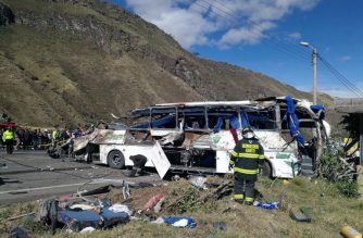 Photo released by the Fire Brigade of Quito showing firefighters working at the scene of an accident where a bus crashed into another vehicle, in the road between Pifo and Papallacta, 30 kilometres east of Quito, leaving at least 24 people dead and 20 injured, on August 14, 2018. / AFP Photo/ Fire Brigade of Quito / HO