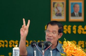 Cambodia's Prime Minister Hun Sen delivers his address before a huge gathering for garment workers in Phnom Penh on August 15, 2018. / AFP Photo