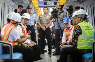 [FILES] This file photo taken on July 13, 2018 shows Indonesia's President Joko Widodo (2nd L) and high-ranking officials sitting inside a light rail transit (LRT) rail car at Jakabaring station in Palembang, in South Sumatra province, as they inaugurate the line ahead of the coming Asian Games. / AFP Photo / Abdul Qodir