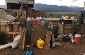 """This handout photo released by the Taos County Sheriff's Office on August 4, 2018 shows a view of a makeshift compound in Amalia, New Mexico, where police rescued 11 children and arrested two armed """"extremists.""""   / AFP Photo / Taos County Sheriff's Office  / Handout"""