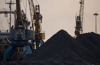 (FILES) This file photo taken on November 21, 2017 shows a general view of North Korean coal piled up on a dockside at the port in Rason. / AFP Photo / Ed Jones