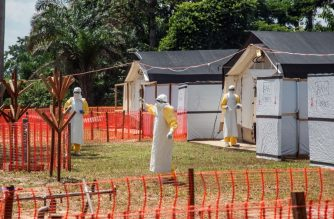 (FILES) In this file photo taken on June 1, 2018 health workers operate within an Ebola safety zone in the Health Center in Iyonda, near Mbandaka. / AFP Photo / Junior D. Kannah