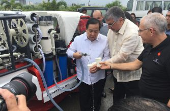Israel Ambassador Effie Ben Matityau and Philippine Red Cross chairman, Senator Richard Gordon, with Pass It Forward CEO Shmuel Weiss, try out the water purified from Pasig River by the GalMobile donated by Israel to the Red Cross.  (Photo courtesy Embassy of Israel and Philippine Red Cross)