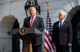 US President Donald Trump, with Vice President Mike Pence, speaks about the economy on the South Lawn of the White House on July 27, 2018, in Washington, DC.  The US economy roared to life in the second quarter, posting the fastest annual growth rate in almost four years and the strongest among industrialized nations, according to government data released Friday. / AFP PHOTO / NICHOLAS KAMM