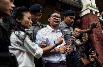 Reuters journalist Wa Lone (C) speaks to journalists after court postponed verdict on August 27, 2018 in Yangon following months of trial since they were detained on December 12, 2017. A Myanmar court postponed ruling on August 27 whether two Reuters journalists, Myanmar nationals Wa Lone, 32, and Kyaw Soe Oo, 28 violated a state secrets law while reporting on the Rohingya crisis, a judge said, with a new date set for next week. / AFP PHOTO / YE AUNG THU