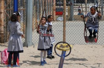 """Palestinian school girls play at UN Relief and Works Agency's (UNRWA) school in the Rafah refugee camp, southern Gaza Strip, on September 1, 2018. The United States announced it was halting funding for the United Nations' agency for Palestinian refugees after declaring the organisation was """"irredeemably flawed. Washington has long been the UN Relief and Works Agency's (UNRWA) largest donor but is """"no longer willing to shoulder the very disproportionate share of the burden,"""" State Department spokeswoman Heather Nauert said in a statement.  / AFP PHOTO / SAID KHATIB"""