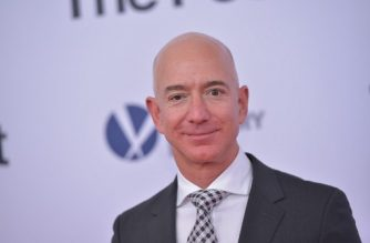 """(FILES) In this file photo taken on December 14, 2017 Amazon CEO Jeff Bezos arrives for the premiere of """"The Post"""" in Washington, DC. As Amazon became the second US firm to hit a trillion-dollar value on the stock market, founder Jeff Bezos regained the crown as the richest person on the planet. Amazon's share price has climbed during the year, lifting the personal wealth of the company's 54-year-old founder with it. Forbes estimated his net worth about $166 billion.  / AFP PHOTO / Mandel NGAN"""