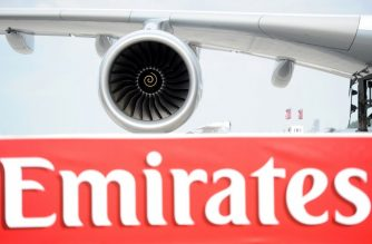 "(FILES) In this file photo taken on June 8, 2010 the logo of Emirates Airlines is pictured in front of an Emirates Airlines A380 aircraft presented at the International Aerospace Exhibition (ILA) at the Schoenefeld airport in Berlin.  Emirates announced September 5, 2018that 10 passengers were taken ill on a 14-hour flight from Dubai to New York, where the aircraft was met by US health authorities. US media showed images of the double decker A380 aircraft isolated on the tarmac at John F. Kennedy International Airport. US media initially reported that 100 passengers had been taken ill and that the jet had been quarantined.""Emirates can confirm that about 10 passengers on EK203 from Dubai to New York were taken ill. On arrival, as a precaution, they were attended to by local health authorities,"" the airline announced.  / AFP PHOTO / Johannes EISELE"