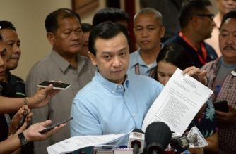 (File photo) Philippine Senator Antonio Trillanes shows documents during a press conference in Manila on September 6, 2018.  Trillanes, who is holed up in the Senate to avoid arrest, has in the past accused Duterte of corruption and his son of involvement in drug dealing, drawing a pledge of revenge from President Rodrigo Duterte who on September 4 ordered the arrest of the lawmaker. / AFP PHOTO / TED ALJIBE