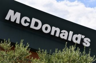 """This photograph taken on September 6, 2018, shows the logo of a McDonalds restaurant in Montpellier, southern France.    From the 1970s it was accused of being the exporter of """"bad food"""" to the land of fine dining, blamed for introducing American fast-food. And resistance to the golden arches continues: a mayor on the island of Oleron in western France has famously battled to keep the company out, and the brand is still a favorite target of anti-capitalist protesters during street demonstrations. But in a turn of events that would have had food purists choking, campaigners including local lawmakers have mobilized to save, not shut, a restaurant in one of the poorest suburbs of the southern city of Marseille. / AFP PHOTO / PASCAL GUYOT"""