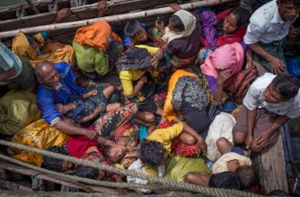 "(FILES) This photograph taken on September 12, 2017 shows Rohingya refugees arriving by boat at Shah Parir Dwip on the Bangladesh side of the Naf River after fleeing violence in Myanmar. The International Criminal Court said on September 6, 2018 it had jurisdiction to probe the forced deportation of Rohingya Muslims by Myanmar's military as a possible crime against humanity. Some 700,000 people from the stateless Muslim minority have fled Myanmar's northern Rakhine state into neighbouring Bangladesh since August last year to escape a bloody military crackdown. The ICC's ""pre-trial chamber... decided by majority the court may exercise jurisdiction over the alleged deportations of the Rohingya people from Myanmar to Bangladesh"", the Hague-based tribunal said in a statement. / AFP PHOTO / Adib Chowdhury"