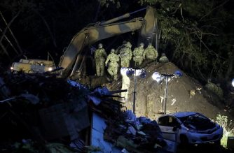 Rescue workers search for missing people in Atsuma town, Hokkaido prefecture on September 7, 2018, a day after a hillside collapsed with the force of the 6.6-magnitude quake. Japanese rescue workers with bulldozers and sniffer dogs scrabbled through the mud to find survivors from a landslide that buried houses after powerful quake, as the death toll rose to 18. / AFP PHOTO / JIJI PRESS / JIJI PRESS / Japan OUT