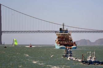 Ocean Cleanup's System 001 is towed out of the San Francisco Bay in San Francisco, California on September 08, 2018. The prototype technology, developed by Boyan Slat, is about 2,000 feet of floating booms that will be towed out to the Great Pacific Garbage Patch, a floating mass of plastics and trash about the size of France, in hopes of helping remove the pollutants.  / AFP PHOTO / JOSH EDELSON