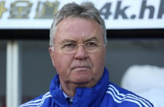 (FILES) This file picture taken on April 9, 2016 shows then Chelsea's Dutch interim manager Guus Hiddink watching his players warm up ahead of the English Premier League football match between Swansea City and Chelsea at The Liberty Stadium in Swansea, south Wales. Highly respected Dutchman Guus Hiddink was named on September 10, 2018 as the new coach of China's under-21 football team, tasked with leading the country at the Tokyo 2020 Olympics. / AFP PHOTO / GEOFF CADDICK