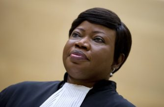(FILES) In this file photo taken on September 29, 2015 Prosecutor Fatou Bensouda waits for former vice-president in the transitional government of the Democratic Republic of the Congo to enter the court room of the International Criminal Court (ICC) to stand trial on charges including corruptly influencing witnesses by giving them money and instructions to provide false testimony, and presenting false evidence, in The Hague. Threats by the United States to sanction judges from the International Criminal Court if pushes ahead with a probe into war crimes in Afghanistan have further strained Washington's relationship with the tribunal. The ICC's chief prosecutor Fatou Bensouda in November 2017 asked the court's judges to authorise her to open a full-blown investigation into war crimes and crimes against humanity committed in Afghanistan, including by US forces and members of the CIA. / AFP PHOTO / POOL / PETER DEJONG