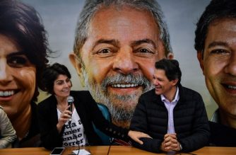 (FILES) In this file picture taken on August 7, 2018 Manuela D'Avila (L), of Brazil's Communist Party (PCdoB), smiles during a press conference with former Sao Paulo's Mayor Fernando Haddad, of the Workers Party (PT), in Sao Paulo, Brazil, on August 7, 2018.  D'Avila was named as Fernando Haddad's running mate for the Workers' Party (PT) after Brazil's jailed ex-leader Luiz Inacio Lula da Silva resigned his candidacy for another presidential term on September 11, 2018 as he serves a corruption sentence and named his own running mate Haddad as his replacement for the October 7 election before a court-ordered deadline. / AFP PHOTO / Nelson ALMEIDA