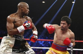 "(FILES) In this file photo taken on May 02, 2015 Floyd Mayweather Jr. (L) defends against Manny Pacquiao (R) during their welterweight unification bout at the MGM Grand Garden Arena in Las Vegas, Nevada.  Former world welterweight champion Floyd Mayweather said Saturday, September 15, 2018 he will face Manny Pacquiao later this year in a rematch of their 2015 superfight.  In a posting on Instagram, Mayweather said he will come out of retirement to fight Pacquiao, three years after scoring a comfortable points victory over the veteran Filipino. ""I'm coming back to fight Manny Pacquiao this year another 9 figure pay day on the way,"" Mayweather wrote on Instagram. No further details were given.  / AFP PHOTO / JOHN GURZINSKI"