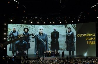 "The cast of ""Game of Thrones"" celebrates the award Outstanding Drama series  onstage during the 70th Emmy Awards at the Microsoft Theatre in Los Angeles, California on September 17, 2018. / AFP PHOTO / Robyn Beck"