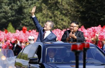 "North Korean leader Kim Jong Un (R) and South Korean President Moon Jae-in (L) wave to Pyongyang citizens from an open-topped as they drive through Pyongyang on September 18, 2018. South Korea's president and the North's leader Kim Jong Un drove through the streets of Pyongyang together past thousands of cheering citizens on September 18, ahead of a summit where Moon Jae-in will seek to reboot stalled denuclearisation talks between North Korea and the United States. / AFP PHOTO / Pyeongyang Press Corps / - / RESTRICTED TO EDITORIAL USE - MANDATORY CREDIT ""AFP PHOTO / Pyeongyang Press Corps"" - NO MARKETING NO ADVERTISING CAMPAIGNS - DISTRIBUTED AS A SERVICE TO CLIENTS"
