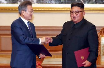 "South Korean President Moon Jae-in (L) shakes hands with North Korean leader Kim Jong Un (R) during a signing ceremony after their summit at Paekhwawon State Guesthouse in Pyongyang on September 19, 2018. North Korean leader Kim Jong Un will make a historic visit to Seoul ""in the near future"", he said on September 19, after a summit with the South's Moon Jae-in in Pyongyang. / AFP PHOTO / Pyeongyang Press Corps / - / RESTRICTED TO EDITORIAL USE - MANDATORY CREDIT ""AFP PHOTO / Pyeongyang Press Corps"" - NO MARKETING NO ADVERTISING CAMPAIGNS - DISTRIBUTED AS A SERVICE TO CLIENTS"