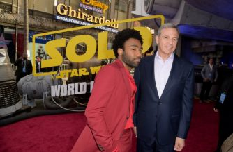 "(FILES) In this file photo taken on May 10, 2018 Donald Glover and Bob Iger, Chief Executive Officer of Disney attend the premiere of Disney Pictures and Lucasfilm's ""Solo: A Star Wars Story"" at the El Capitan Theatre in Hollywood, California.   Disney plans to slow down the release schedule for its blockbuster ""Star Wars"" franchise, CEO Bob Iger has said, acknowledging that it was a mistake to shuttle a new film into theaters every year. Iger's comments to The Hollywood Reporter in an interview published September 20, 2018 come on the back of the disappointing box office take earlier this year of ""Solo: A Star Wars Story"" of $400 million worldwide.While that result would be stellar for most films, it's mediocre at best for a ""Star Wars"" film, leading many industry observers to speculate about franchise fatigue.  / AFP PHOTO / GETTY IMAGES NORTH AMERICA / KEVIN WINTER"