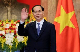 (FILES) In this file photo taken March 23, 2018, Vietnamese President Tran Dai Quang greets journalists as he waits for the arrival of Russian Foreign Minister Sergei Lavrov (not pictured) at the Presidential Palace. Vietnamese President Tran Dai Quang dies on September 21 at the age of 61 after a prologued illness, state run media reported.   / AFP PHOTO / POOL / MINH HOANG