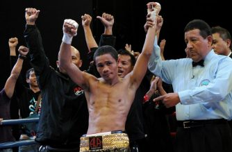World Boxing Organization light-flyweight champion Donnie Nietes (C) of the Philippines celebrates after defeating Mexican challenger Felipe Salguero on June 2, 2012 during a WBO light-flyweight title bout in Manila, retaining his title.               AFP PHOTO / Jay DIRECTO / AFP PHOTO / JAY DIRECTO