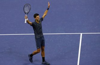 NEW YORK, NY - SEPTEMBER 09: Fans cheer as Novak Djokovic of Serbia celebrates after winning his Men's Singles final match against Juan Martin del Potro of Argentina on Day Fourteen of the 2018 US Open at the USTA Billie Jean King National Tennis Center on September 9, 2018 in the Flushing neighborhood of the Queens borough of New York City.   Jaime Lawson/Getty Images for USTA/AFP