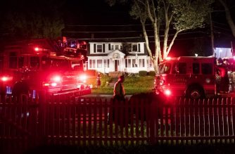 NORTH ANDOVER, MA - September 13: Firefighters inspect a home after a gas explosions on September 13, 2018 in North Andover, Massachusetts. Gas explosions in three communities north of Boston have left multiple homes on fire.   Adam Glanzman/Getty Images/AFP