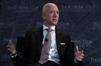 WASHINGTON, DC - SEPTEMBER 13: CEO and founder of Amazon Jeff Bezos participates in a discussion during a Milestone Celebration dinner September 13, 2018 in Washington, DC. Economic Club of Washington celebrated its 32nd anniversary at the event.   Alex Wong/Getty Images/AFP